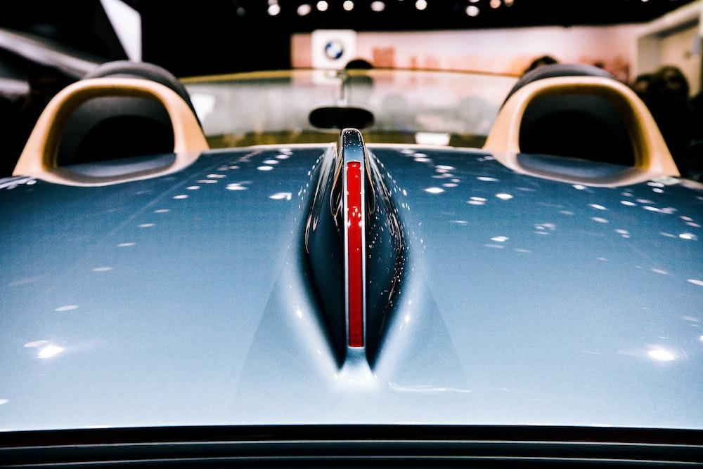closeup photography of blue vehicle hood