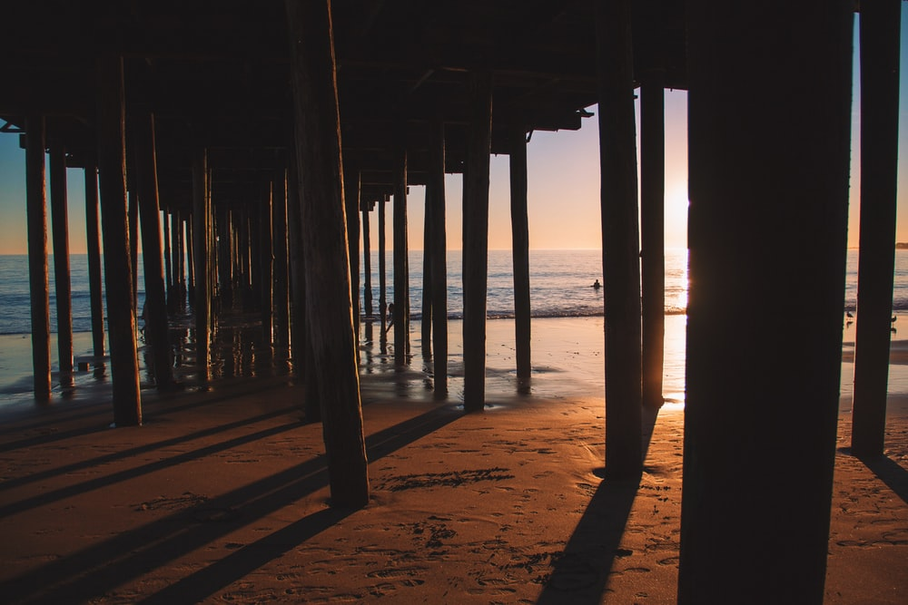 silhouette photo of sea dock