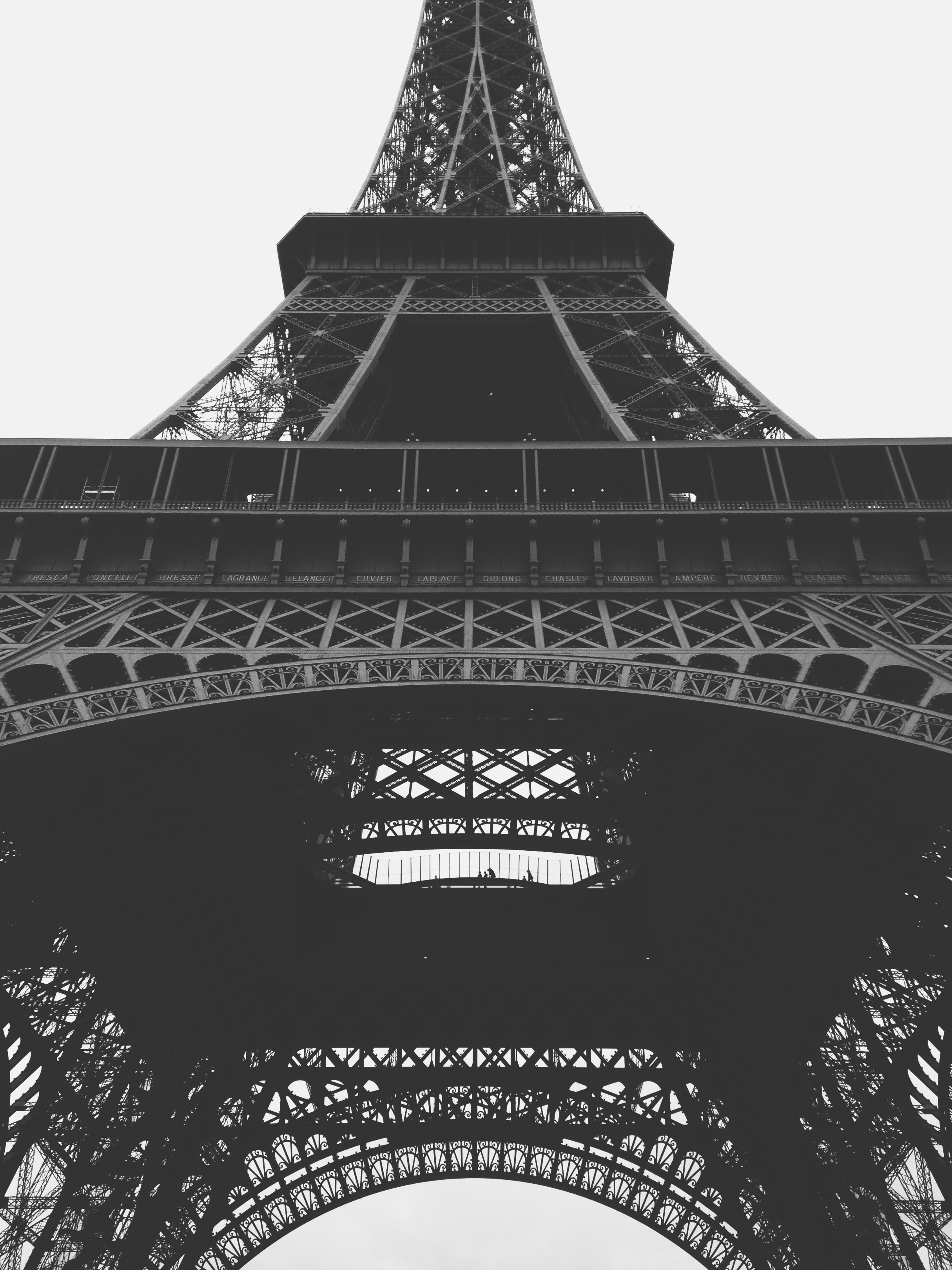 A black-and-white shot of the bottom of the Eiffel Tower