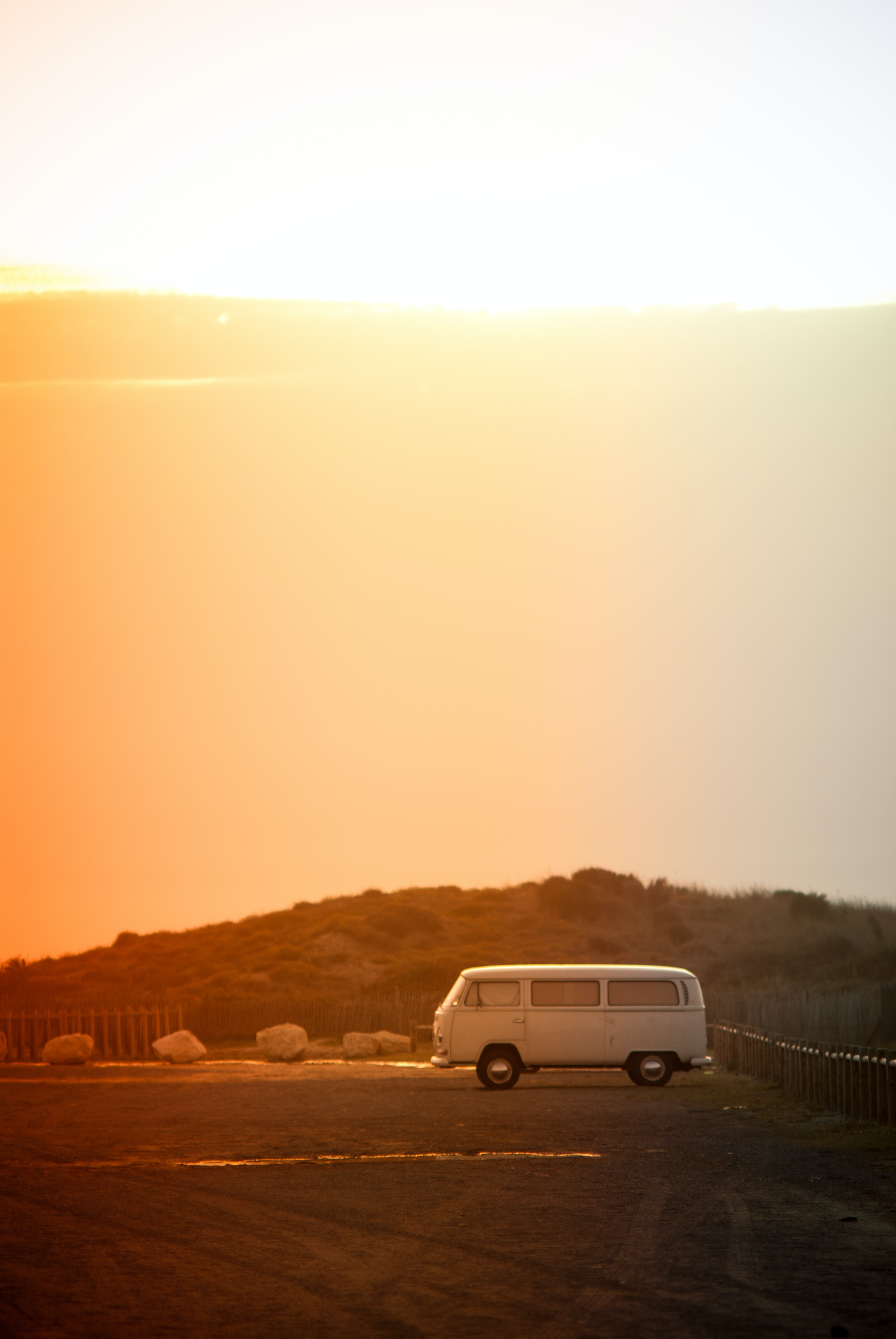 Vintage VW van parked on the side of the desert road
