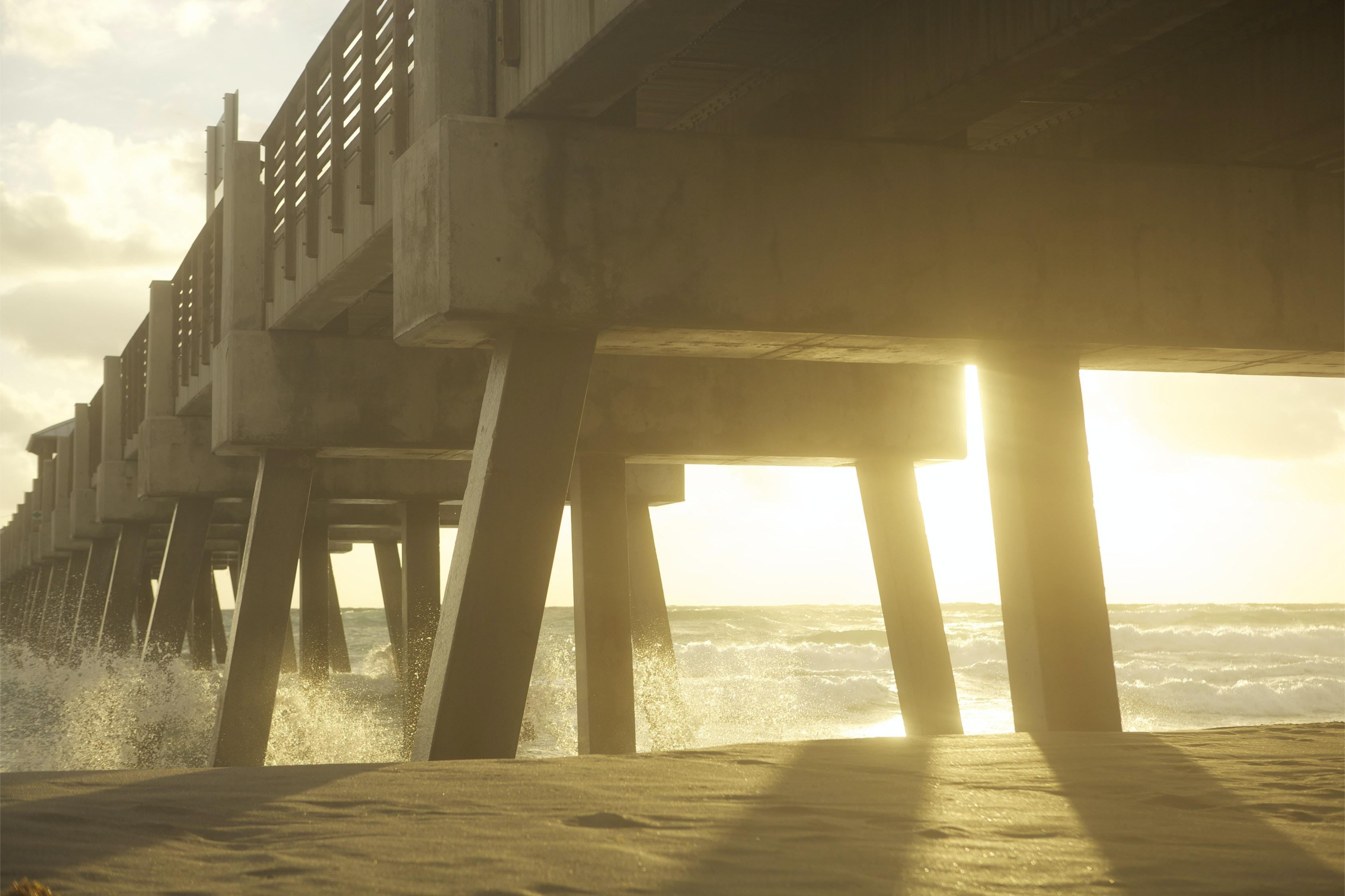 skyline photography of concrete bridge
