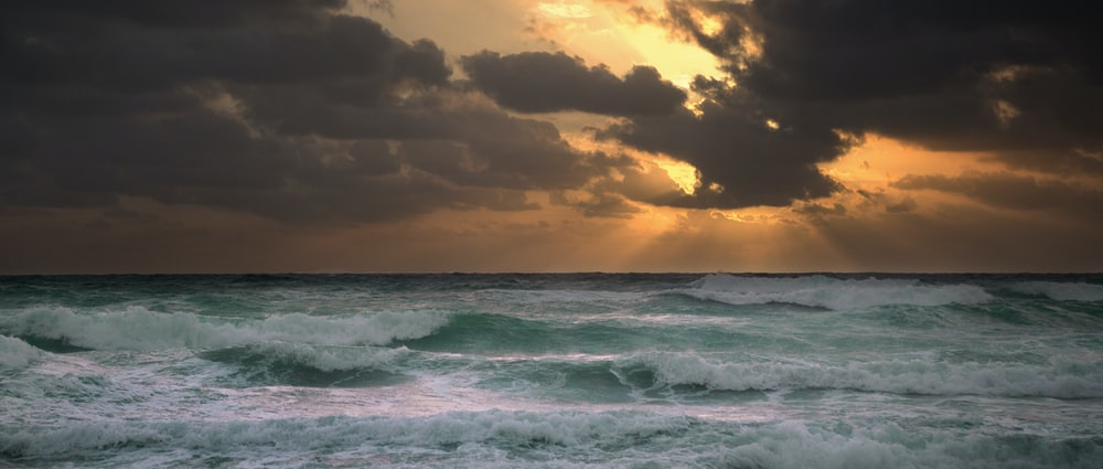 photography of ocean waves during golden hour
