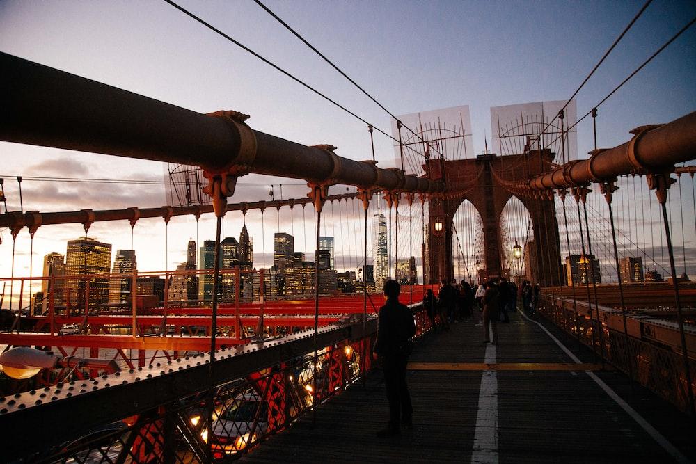 people standing on Brooklyn Bridge