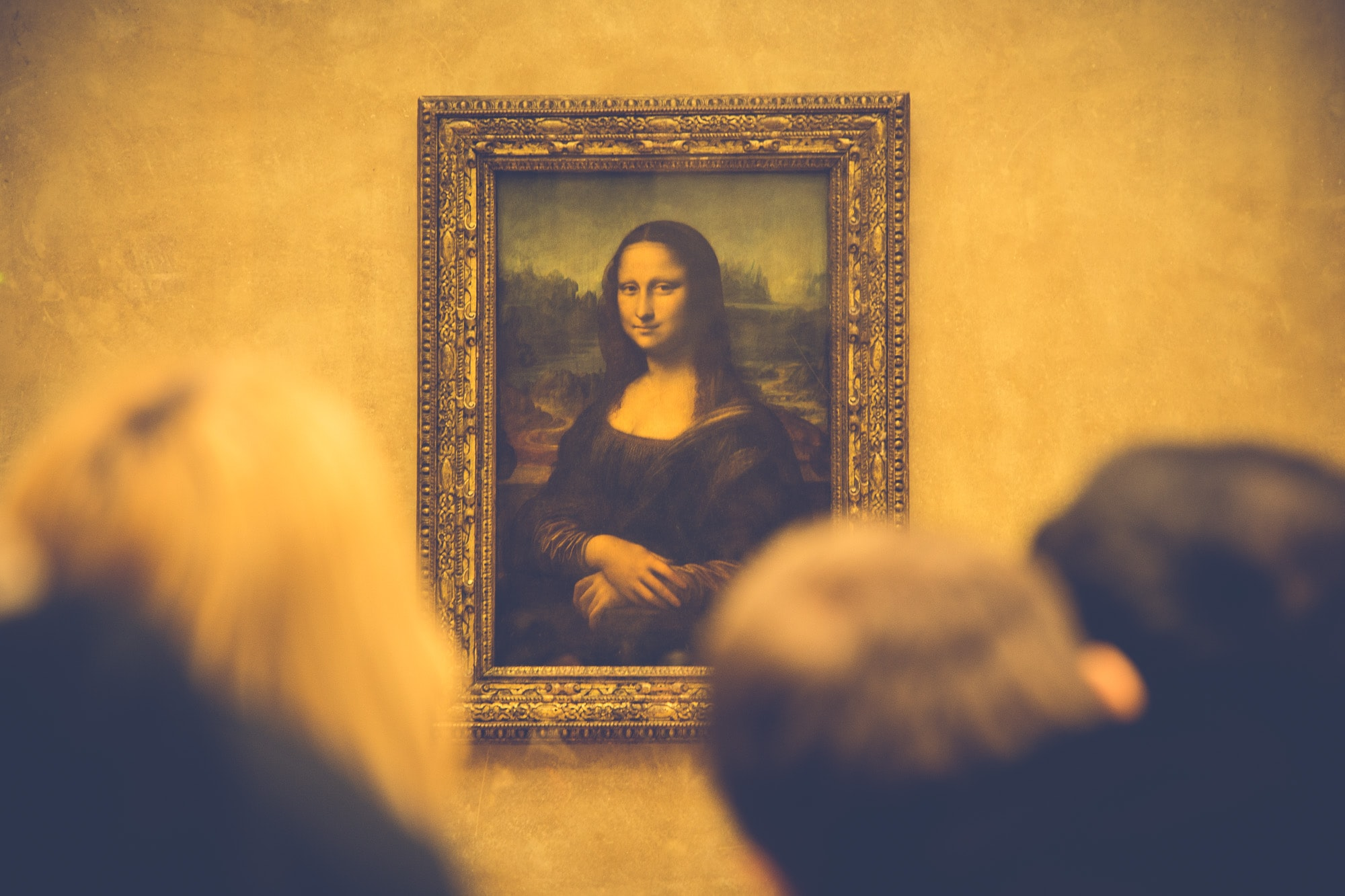 People admiring iconic Mona Lisa painting in Joconde, Louvre
