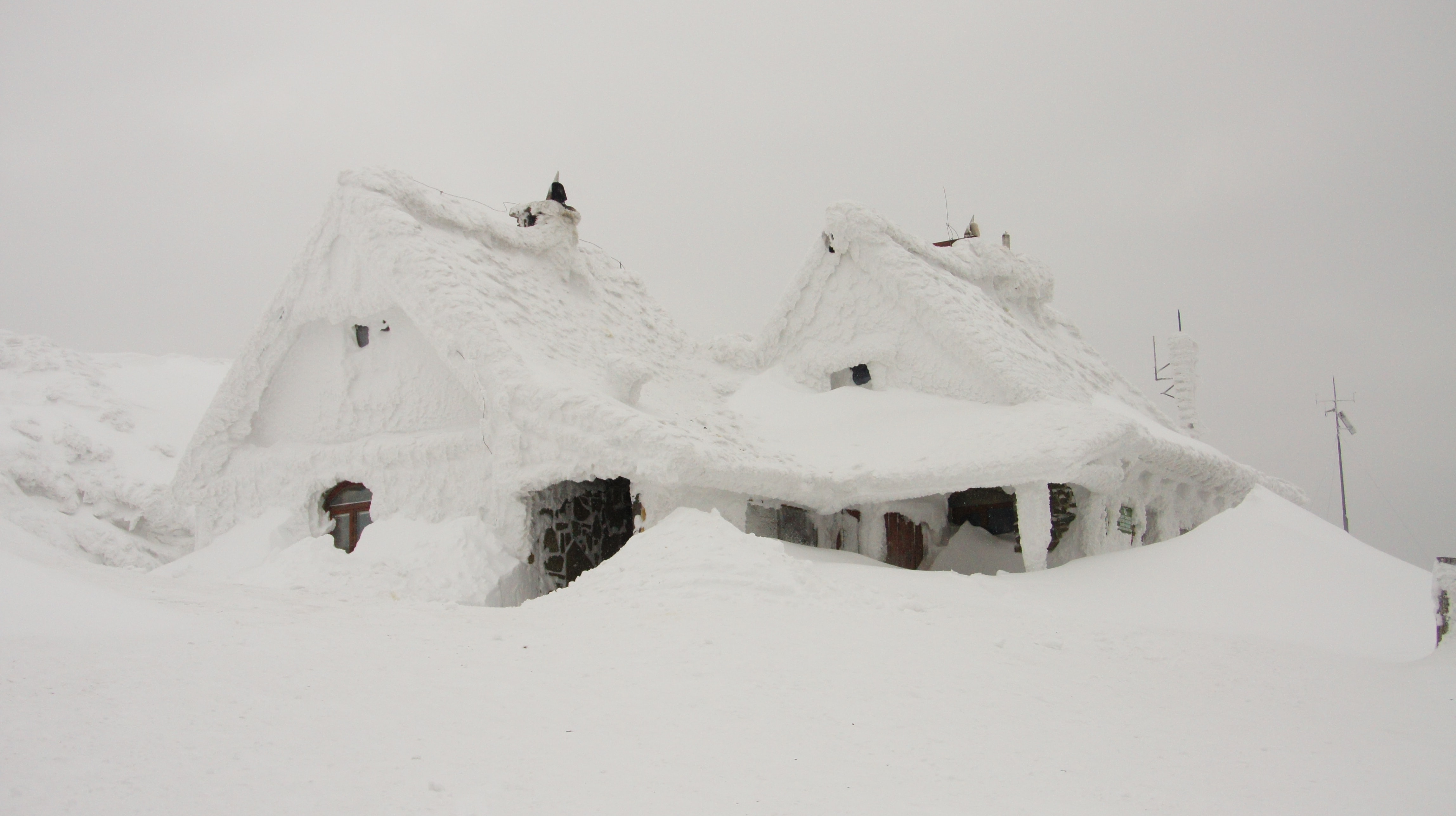 House covered with snow after the blizzard in Winter