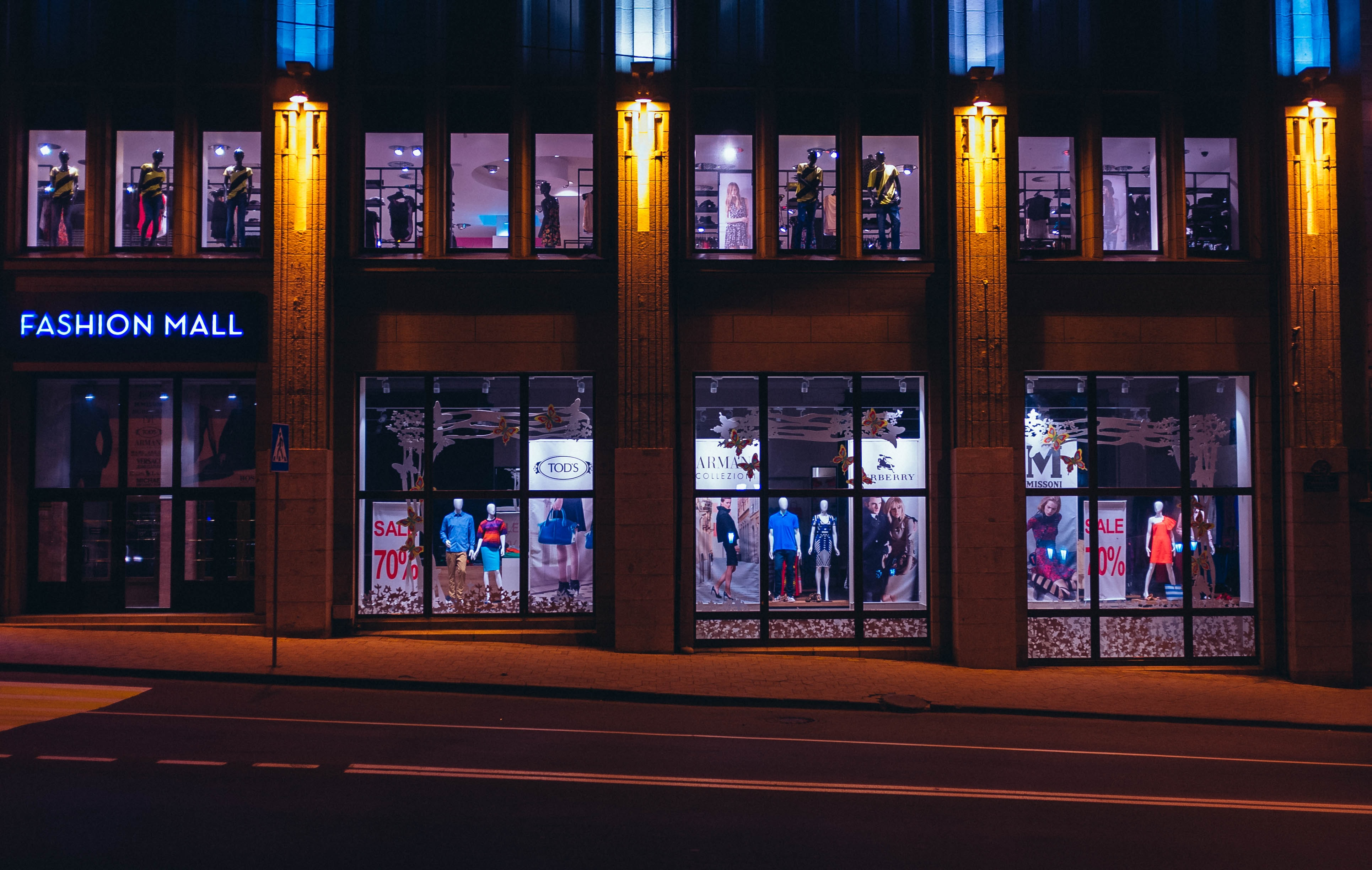 brown Fashion Mall store front photo at nighttime
