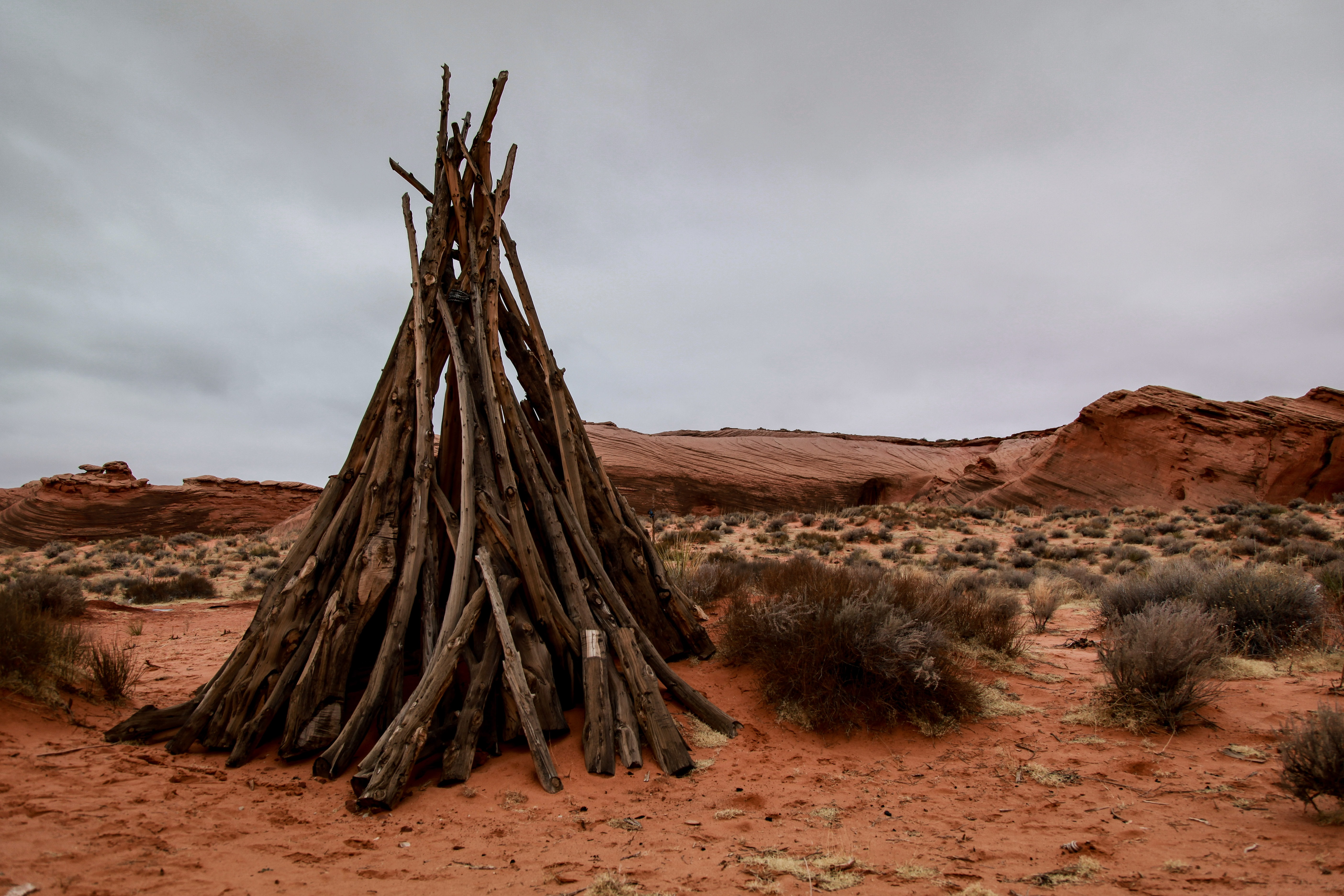 Sticks form a rustic teepee in the desert