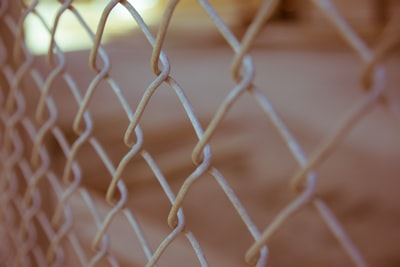 white steel cyclone fence