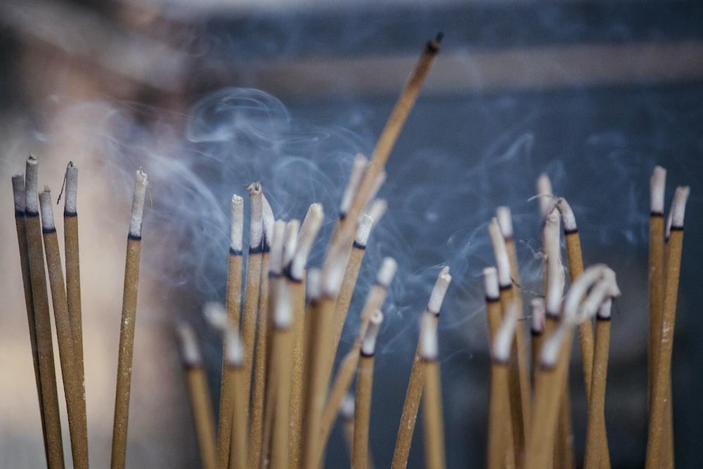 brown wooden sticks with white smoke