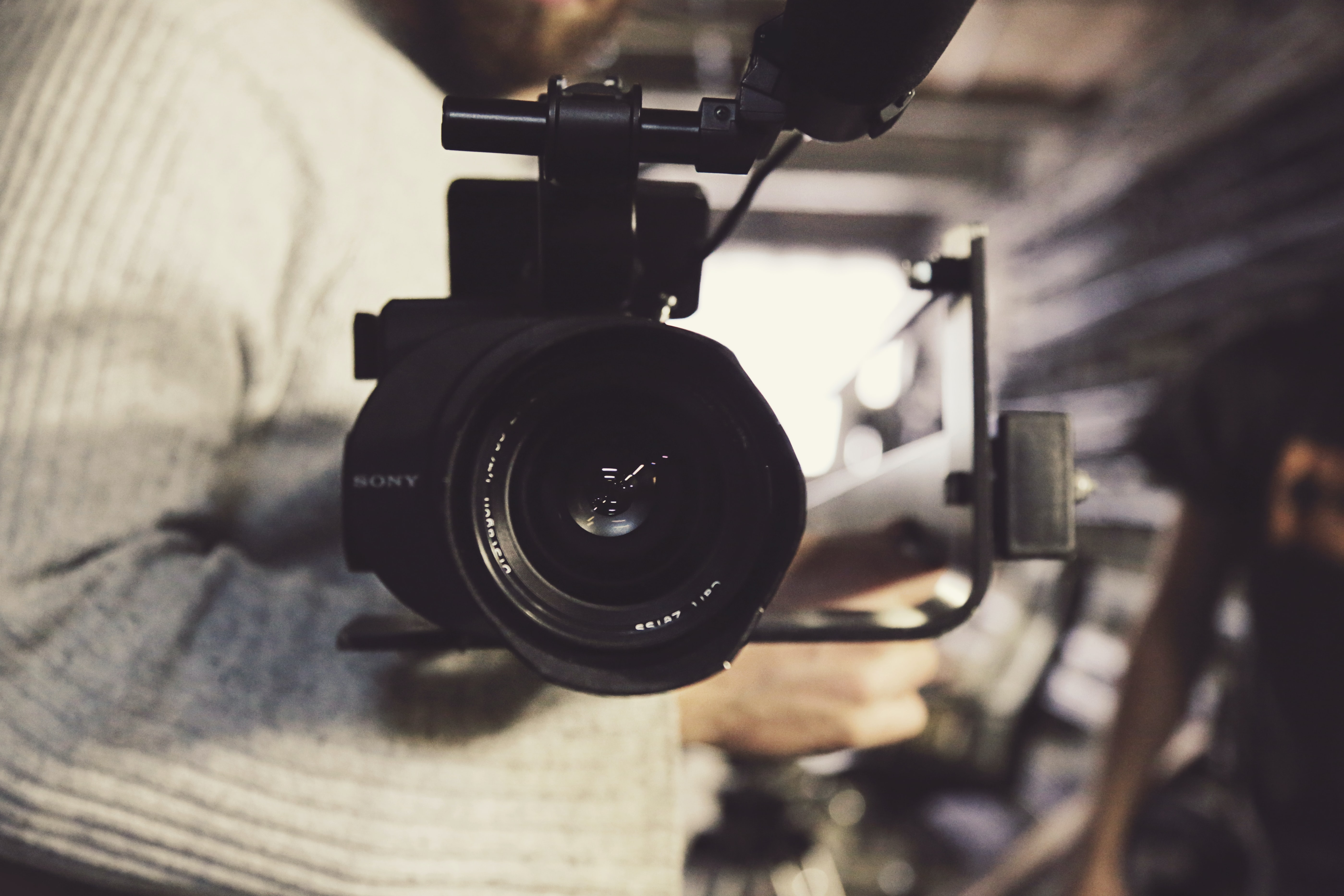 Close-up of a video camera held by a man