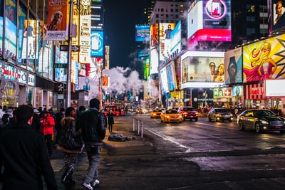 people walking beside buildings new york zoom background