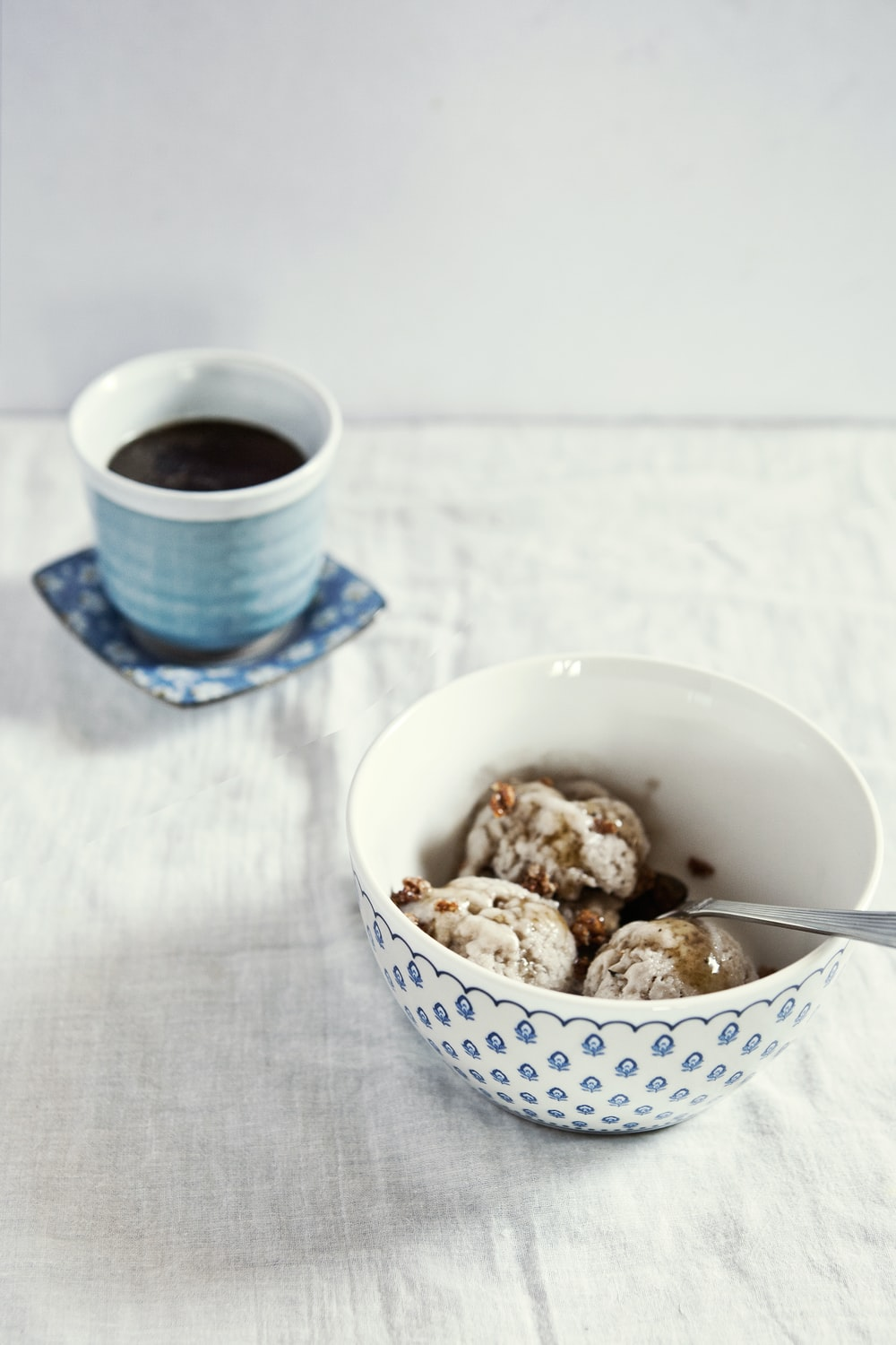 baked pastries in white and blue ceramic bowl