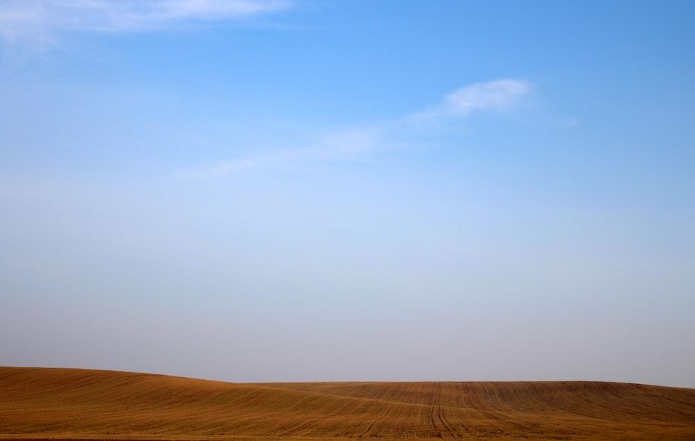 sand dunes under clear sky