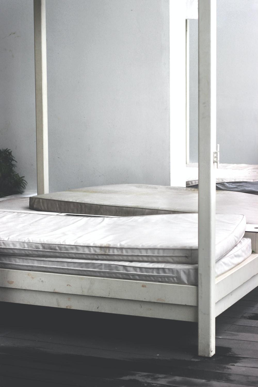 white wooden bed frame
