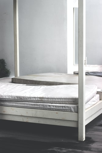 mattresses on a white bed