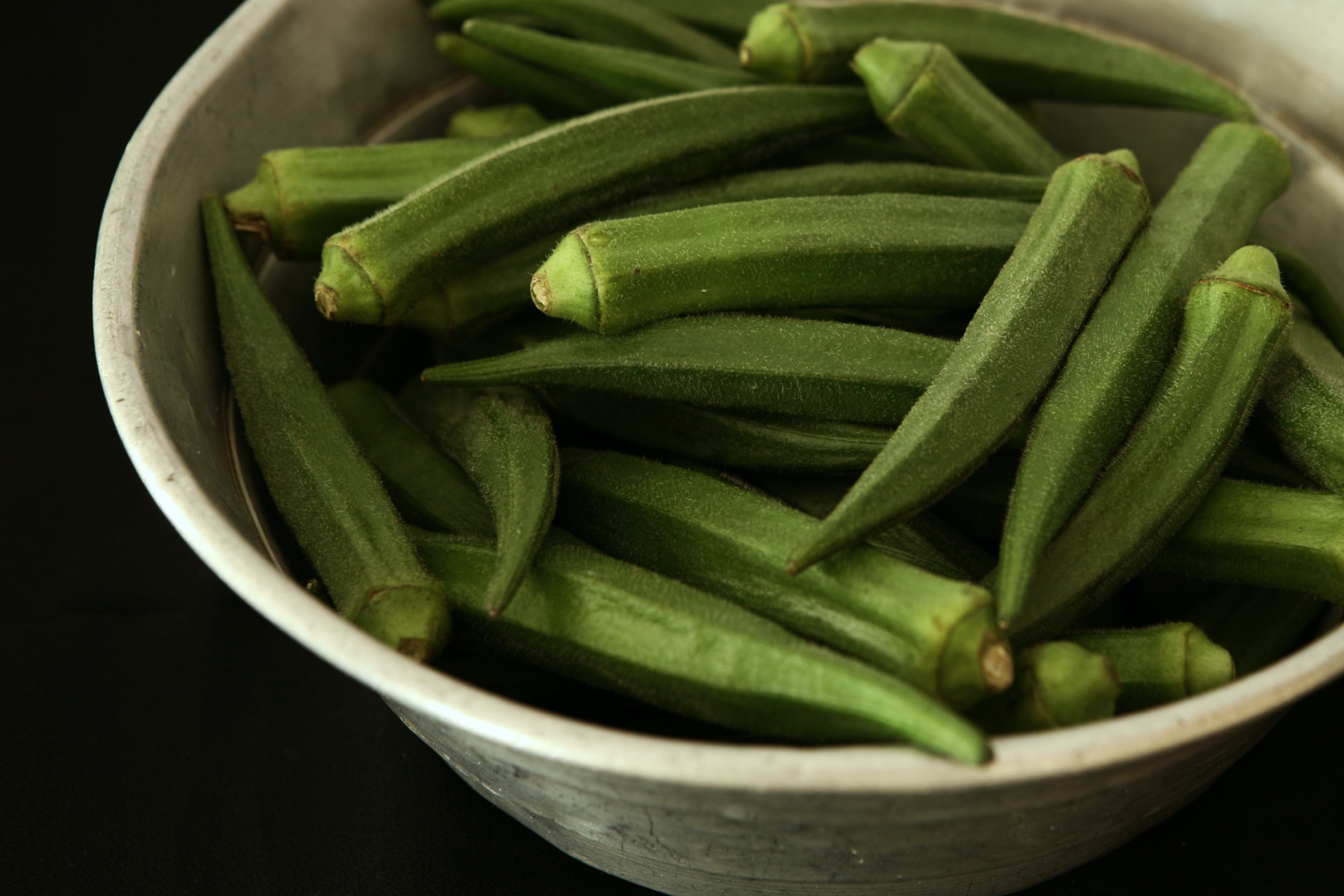 Okra vegetable in white bowl