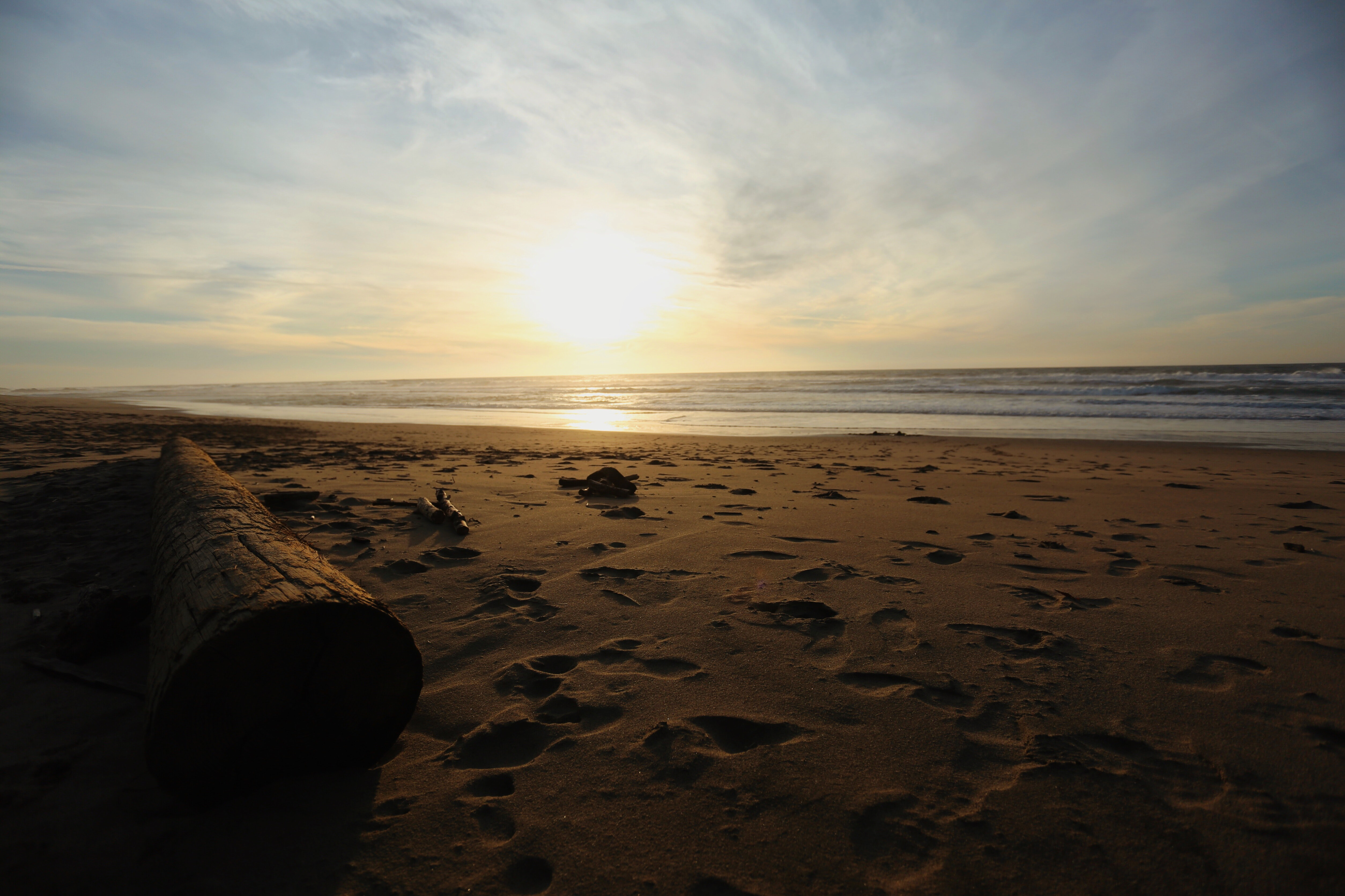 Sunset from the sandy beach with footprints