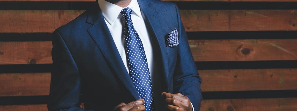 A confident man in a blue blazer