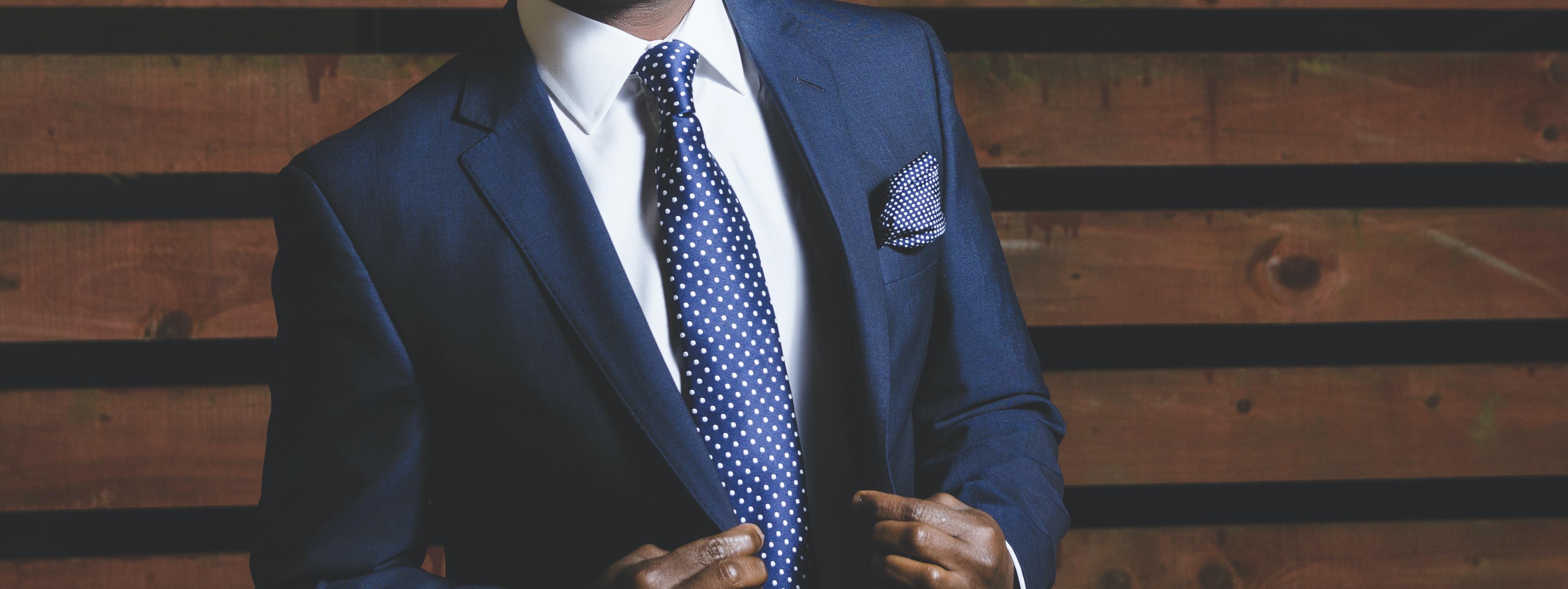 man wearing blue suit