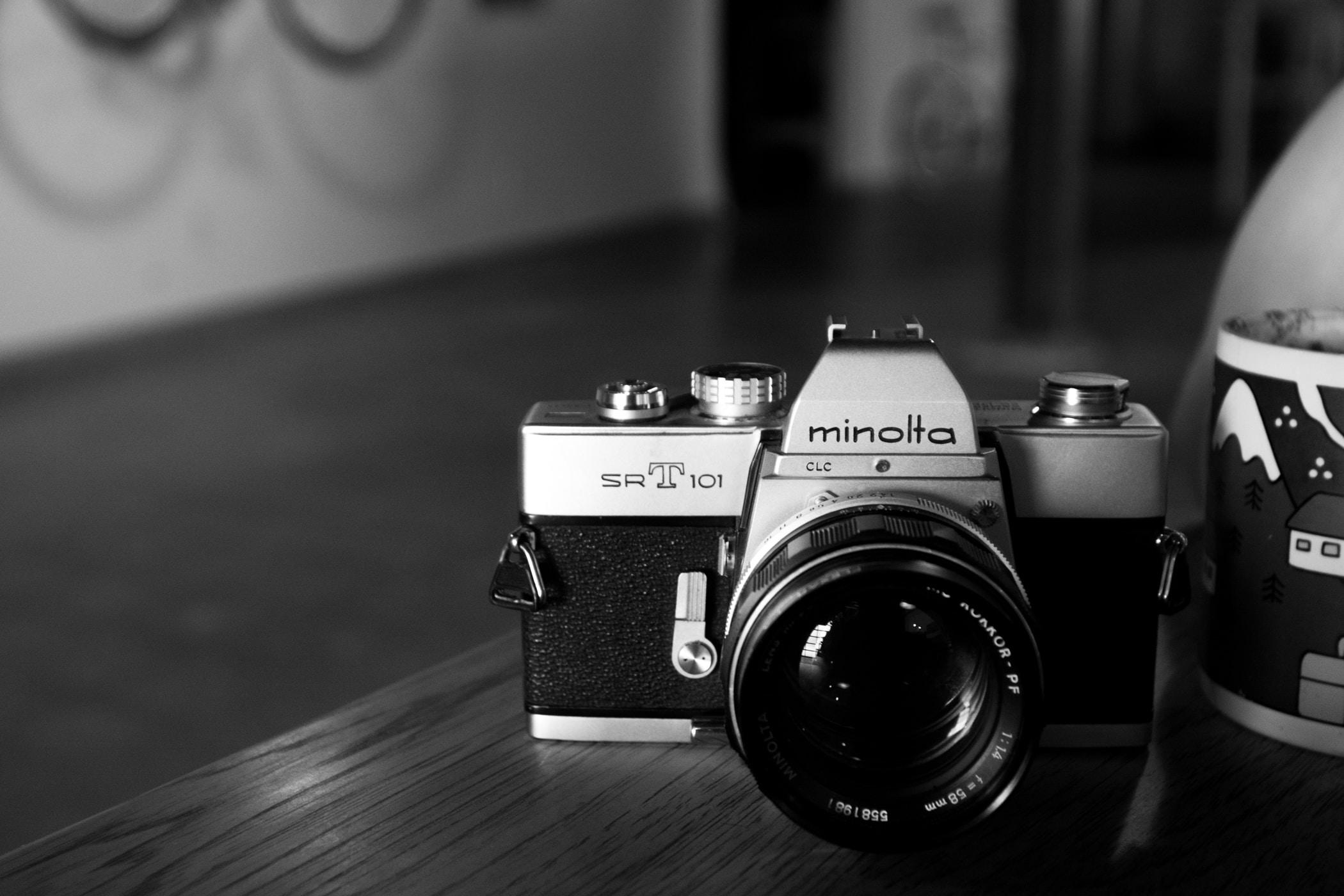 Minolta SLR camera on table