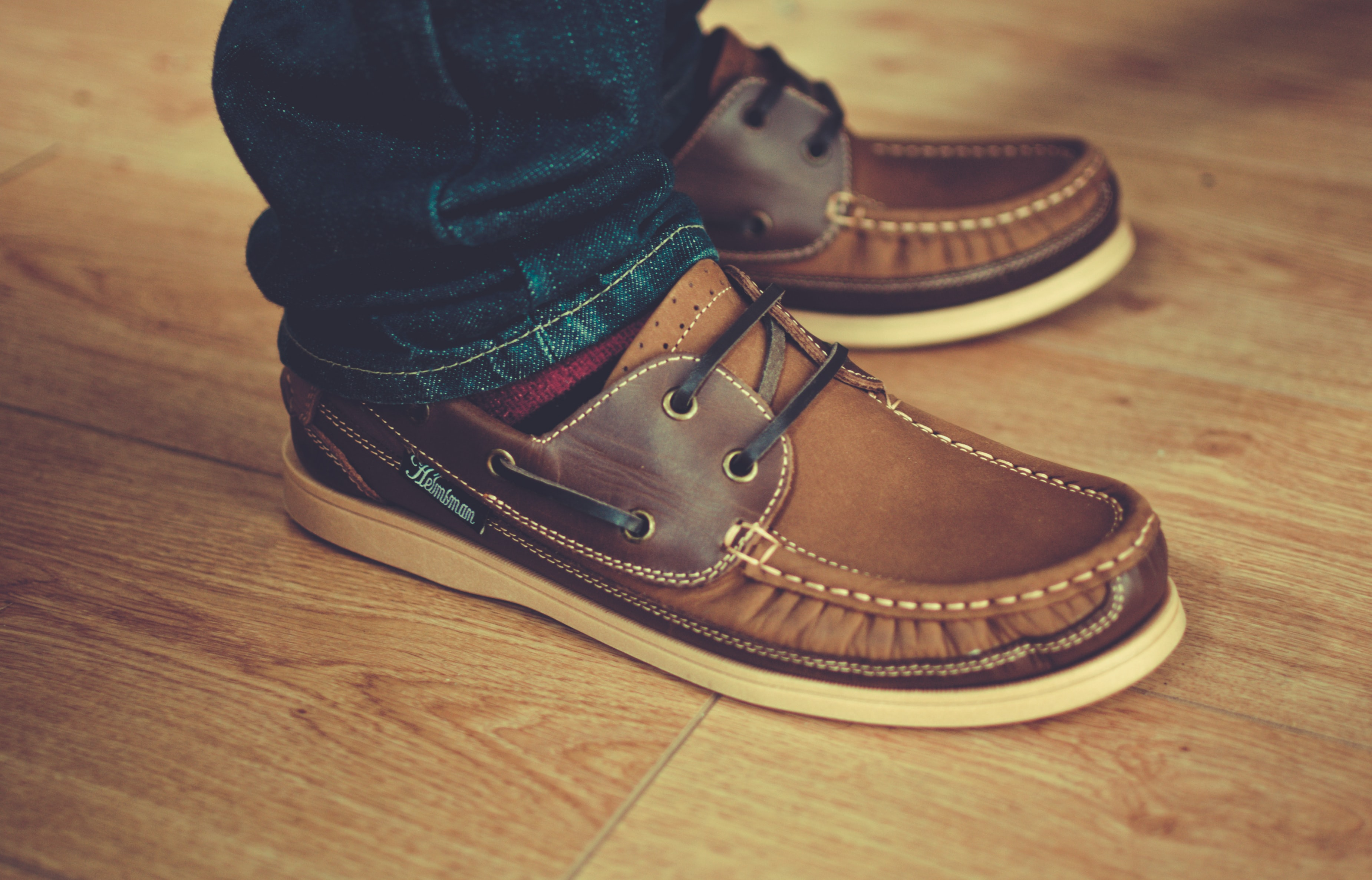 A close-up shot of brown men's loafers on a male's feet