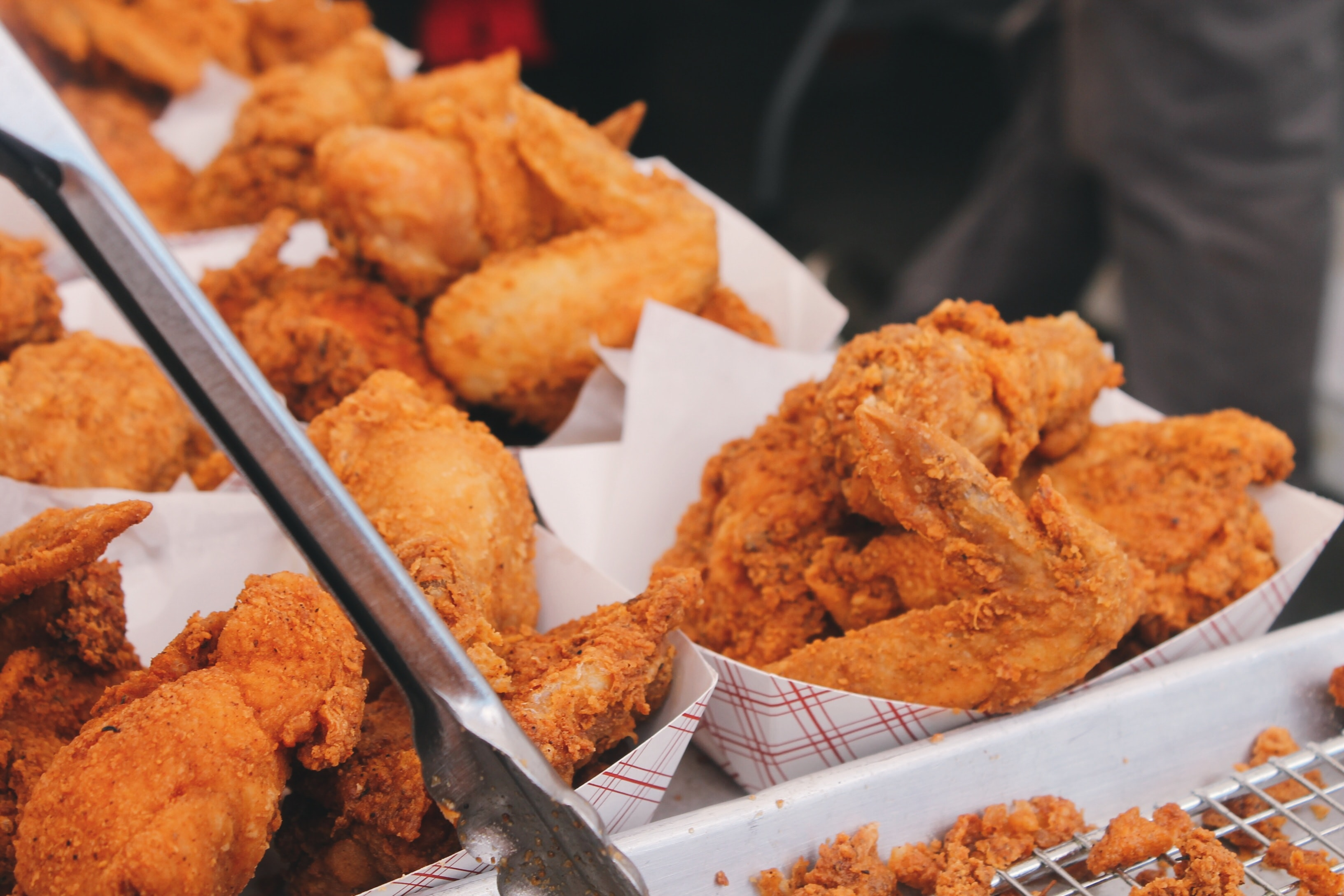 Baskets of American Southern deep-fried chicken at a fast food restaurant