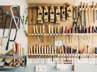 assorted handheld tools in tool rack