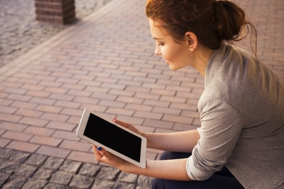 A woman watching something on an iPad