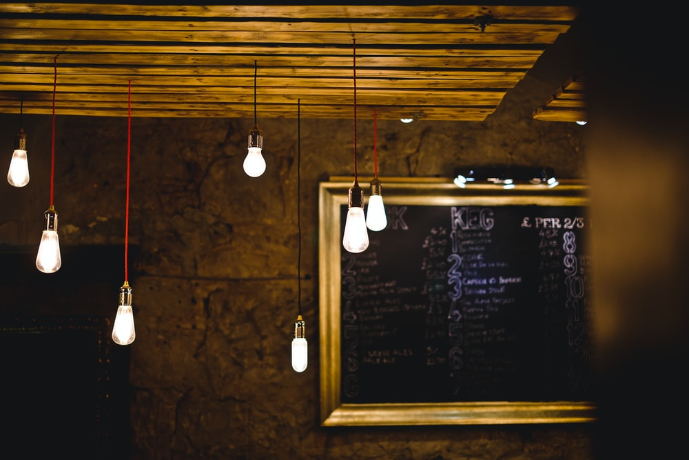 turned on pendant bulb lot beside wall decor