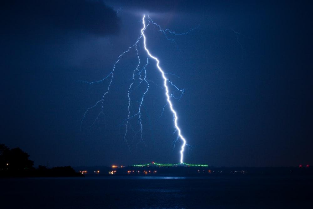 lightning struck on city at night time