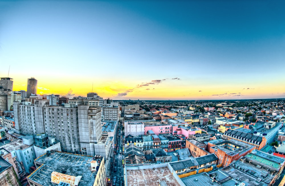aerial photography of city buildings during yellow sunset