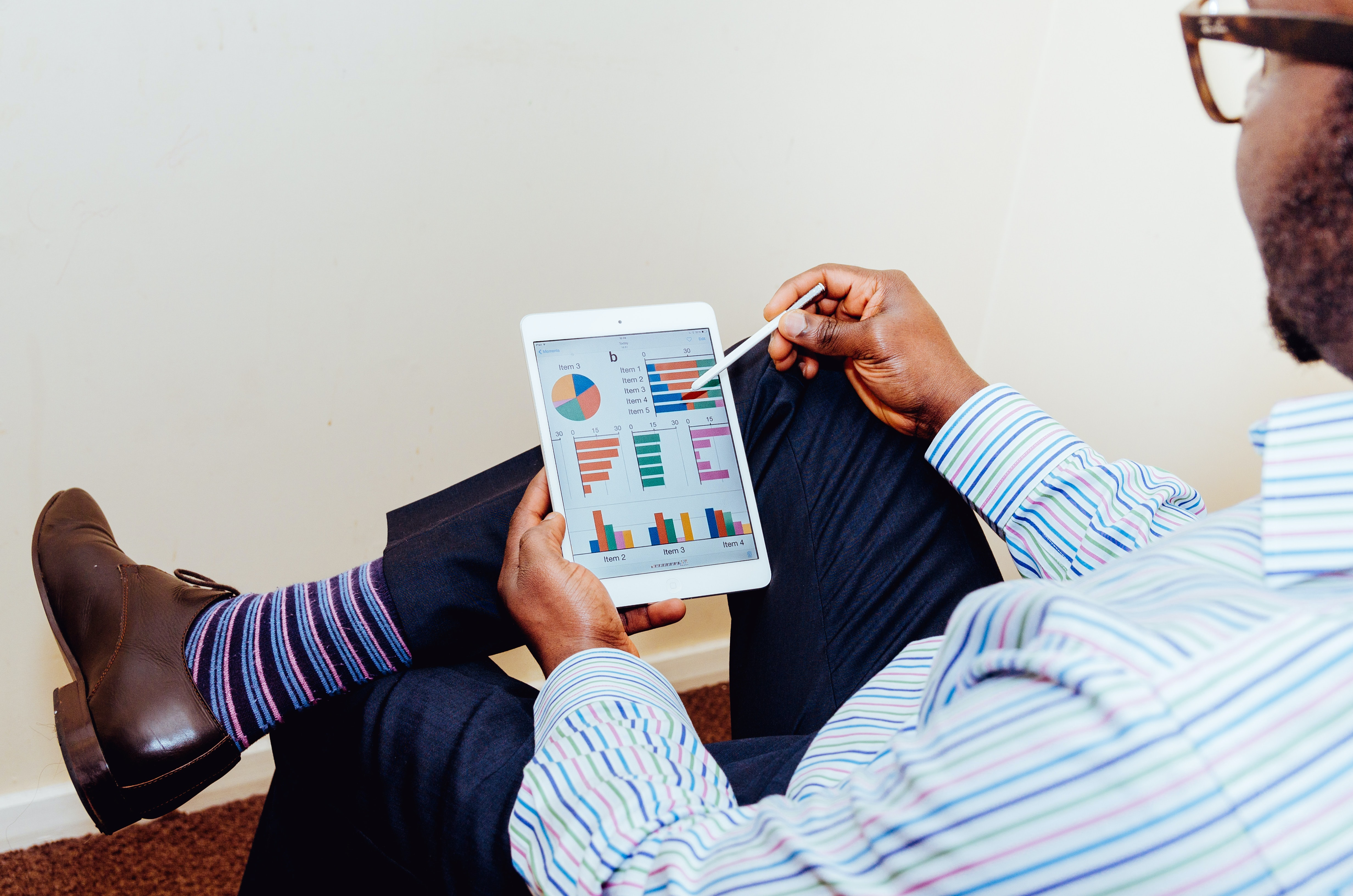 image of man looking at a graph on a tablet