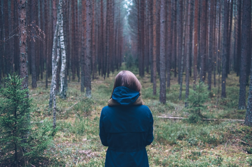 woman in hoodie at forest