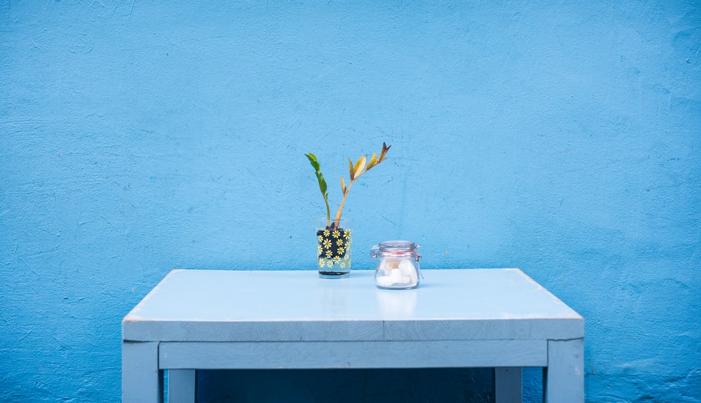clear glass jar on gray wooden table