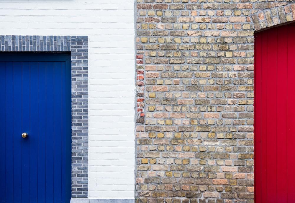 blue wooden door in brick wall