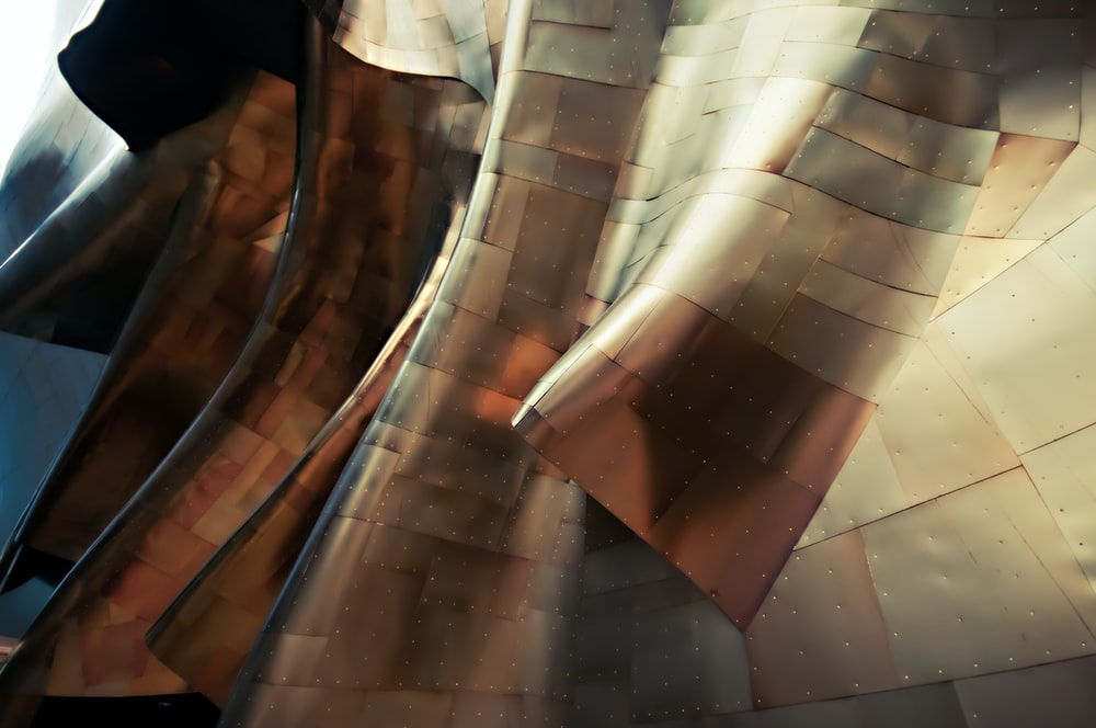 Glossy sheets of metal form abstract shapes in the Experience Music Project Museum