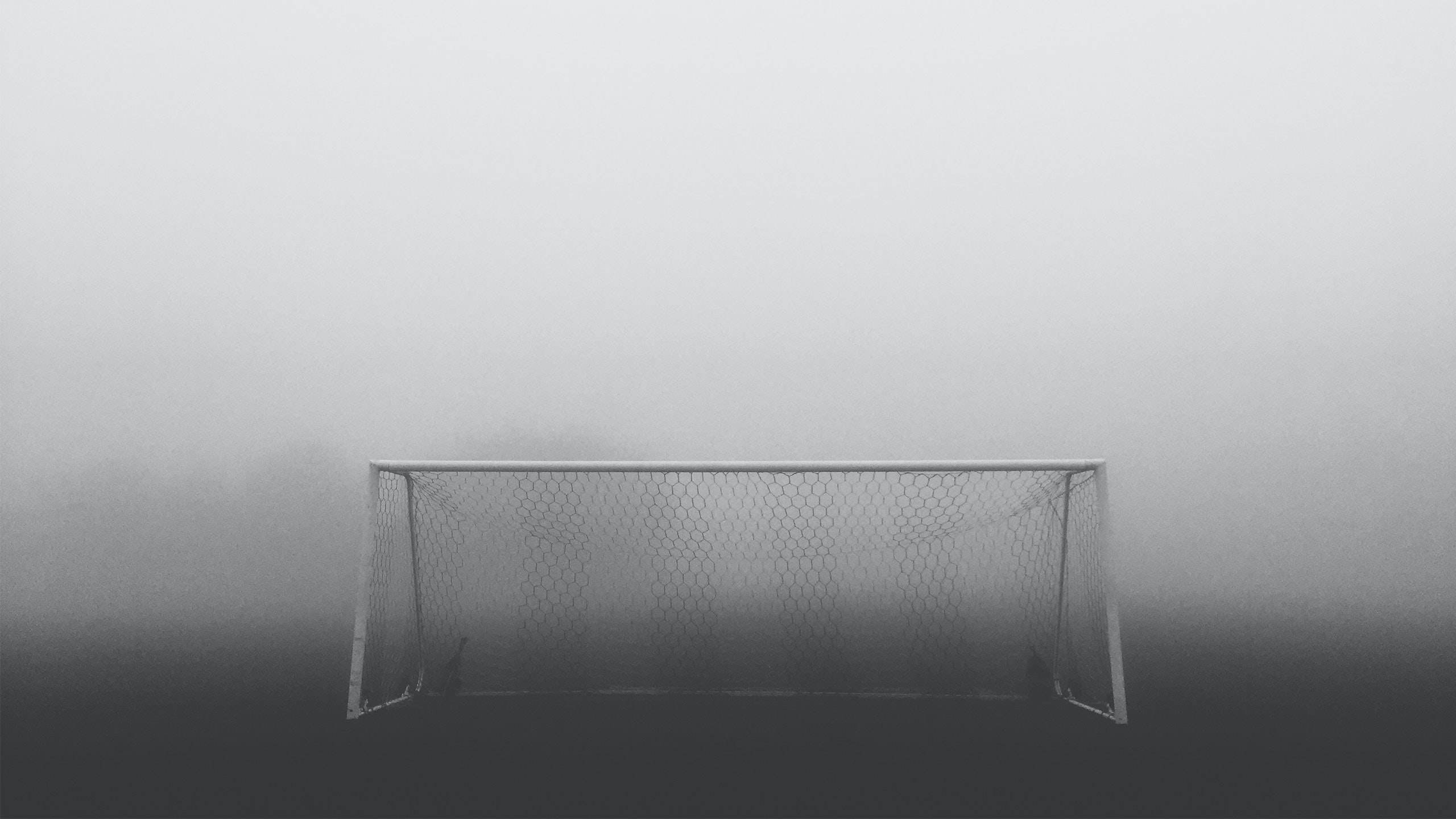 Soccer goal construction with the net in the fog