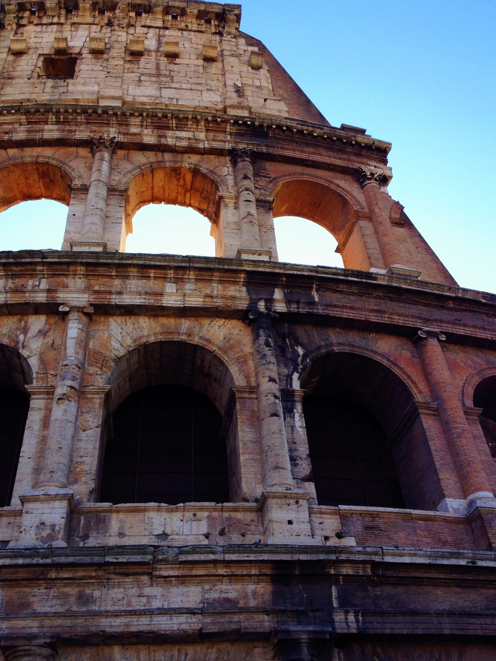 low angle photo of brown coloseum