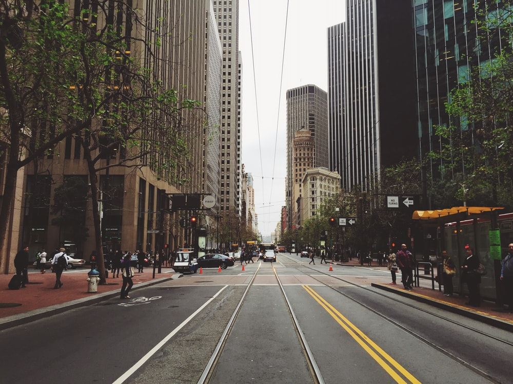 people walking on city sidewalk