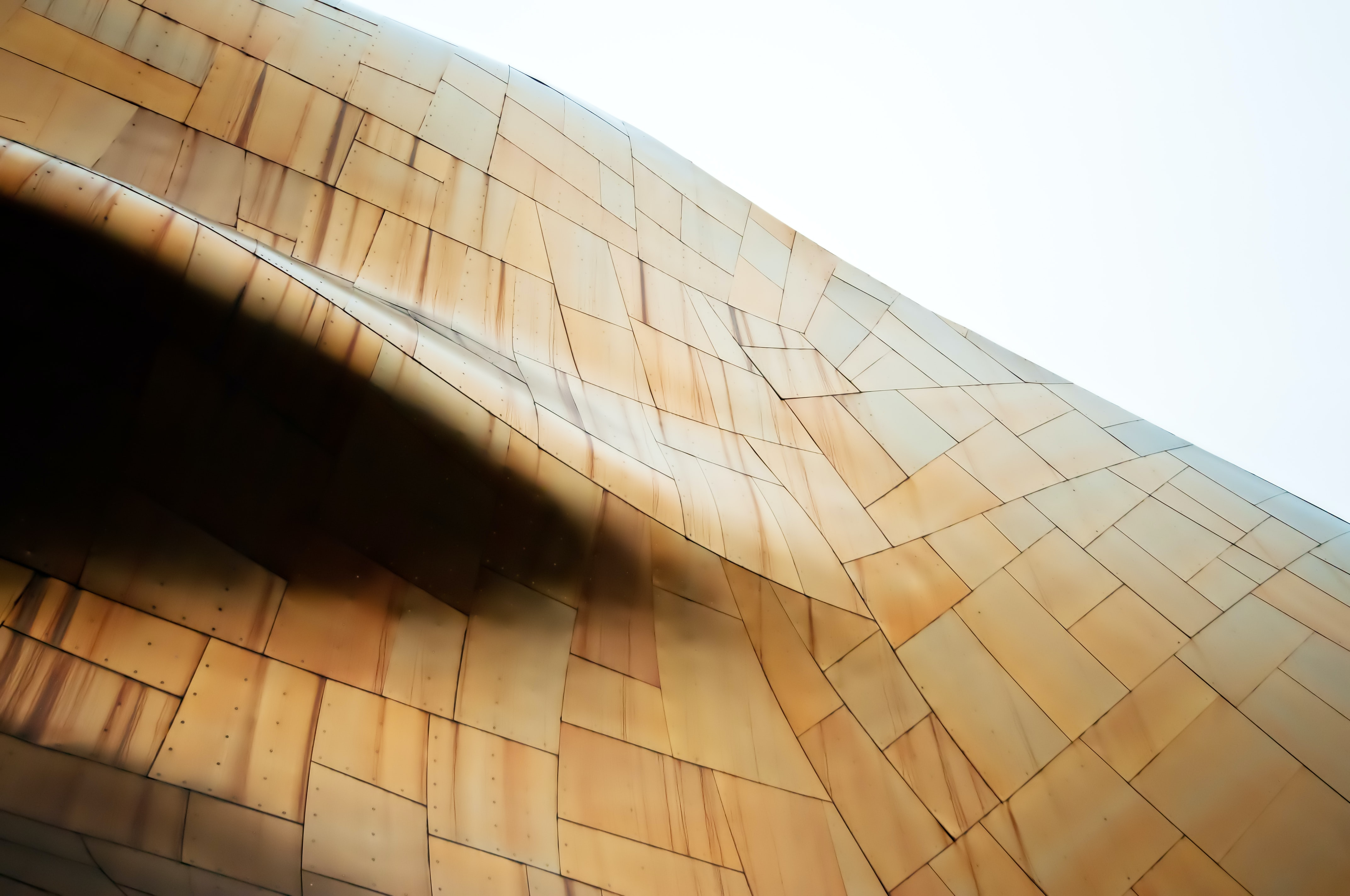 An abstract shape formed by a building façade made of metal sheets