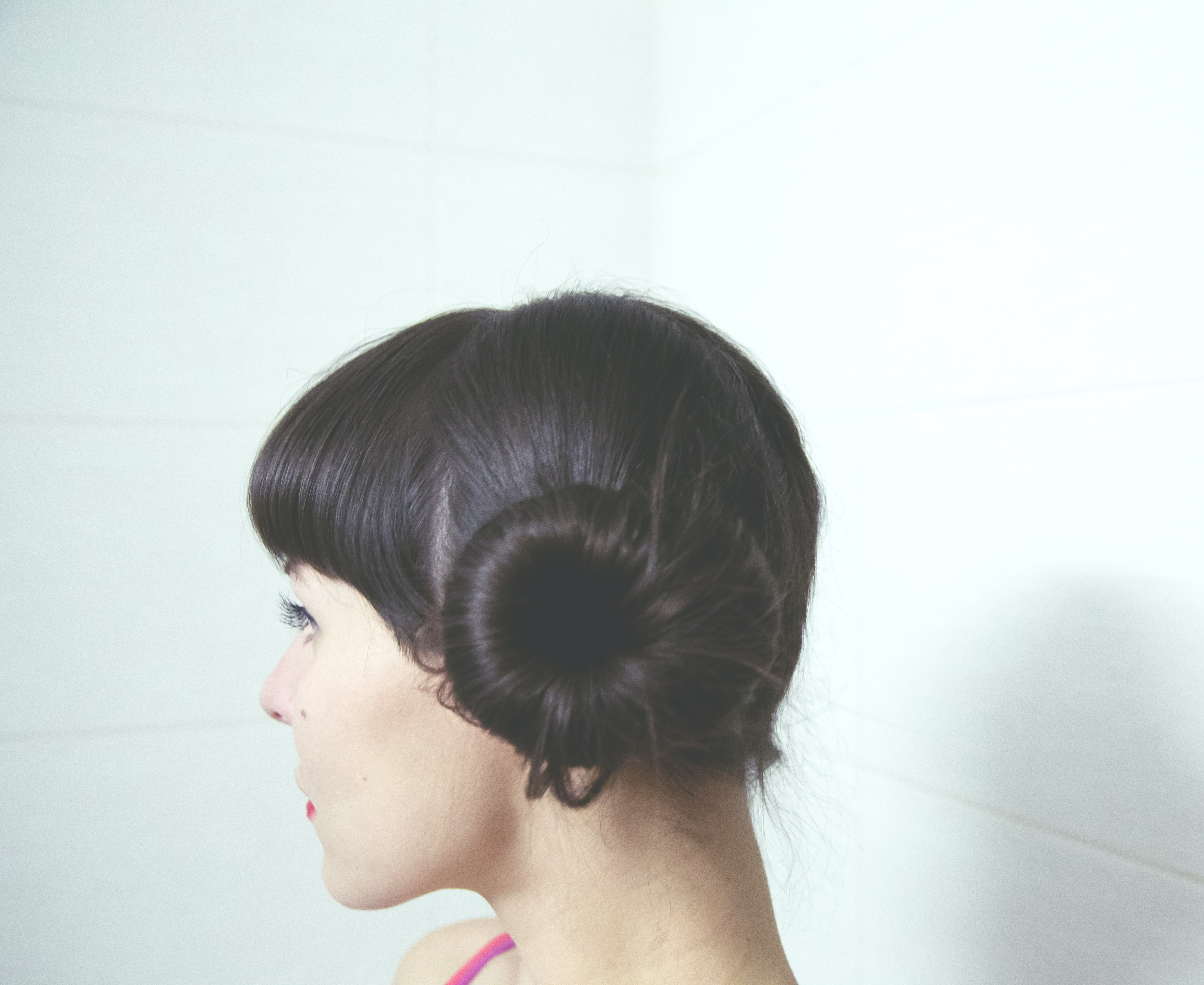 woman with straight black hair bun