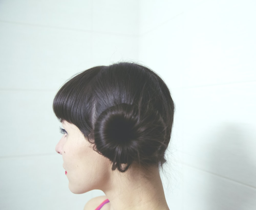 woman with straight black hair bun