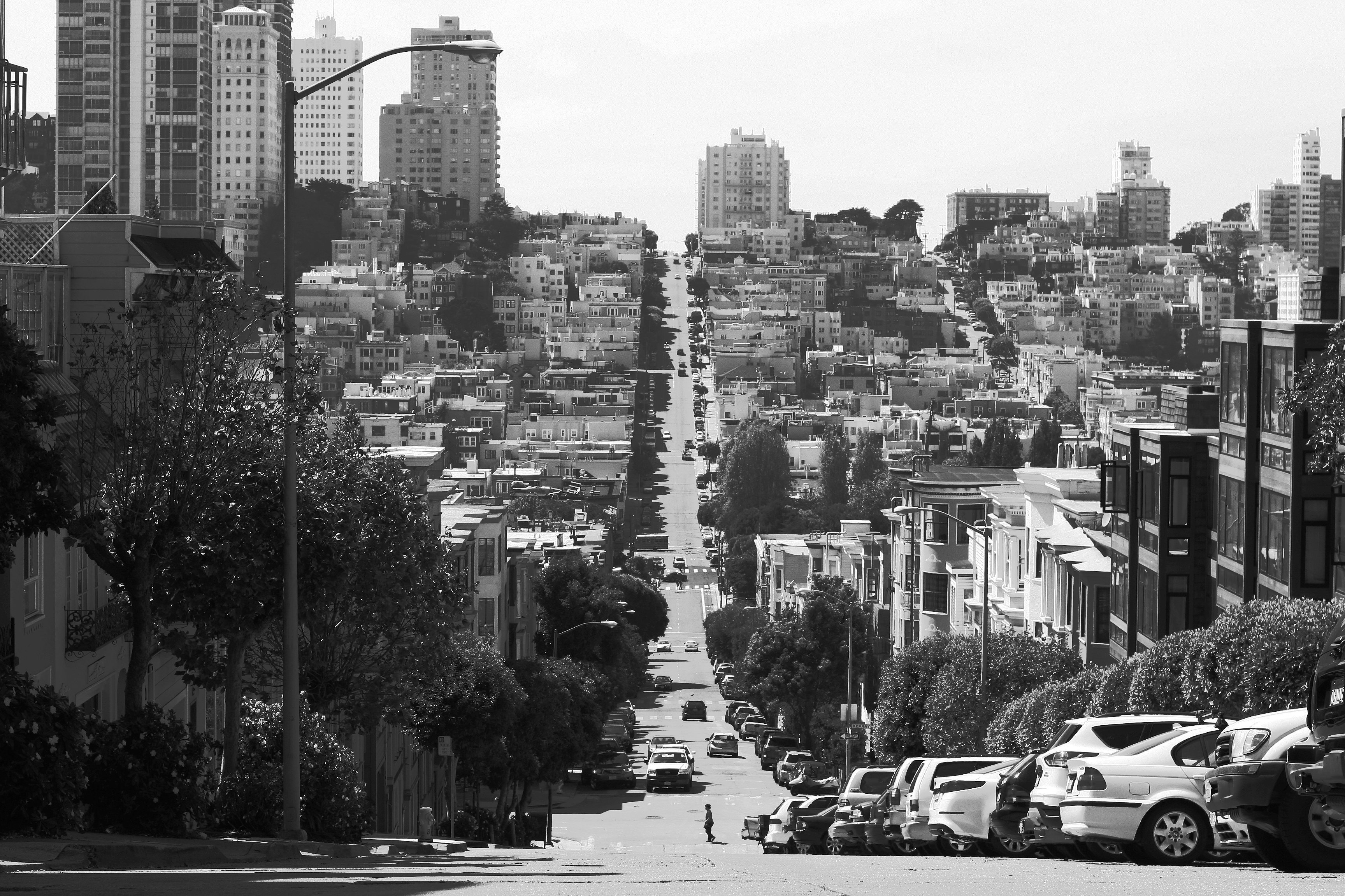 A person skateboarding down a huge hill in San Francisco