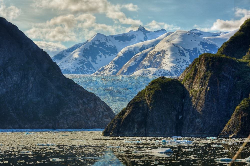 photography of mountain near body of water