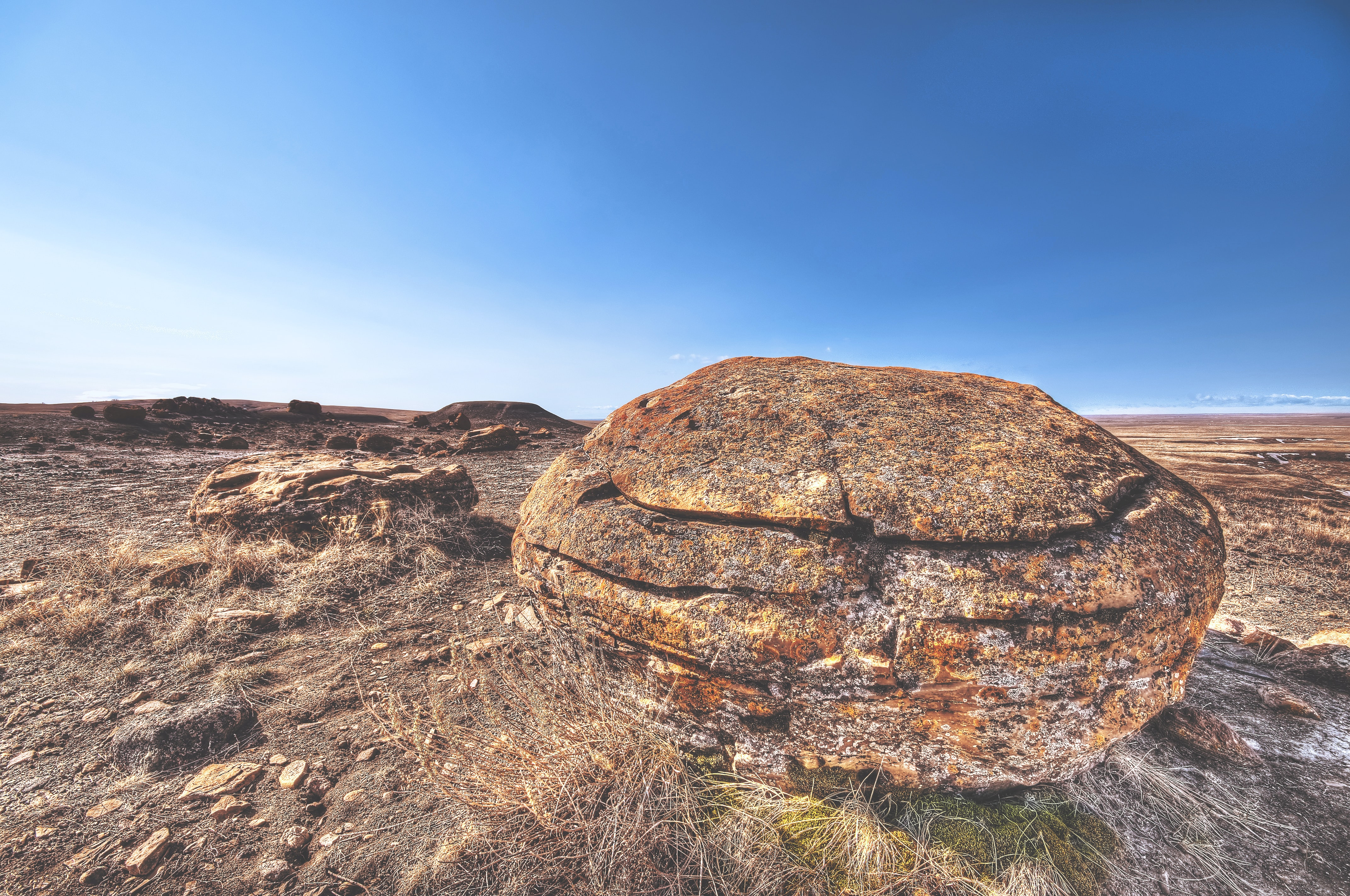 brown rock on deserted land under blue sky during daytime