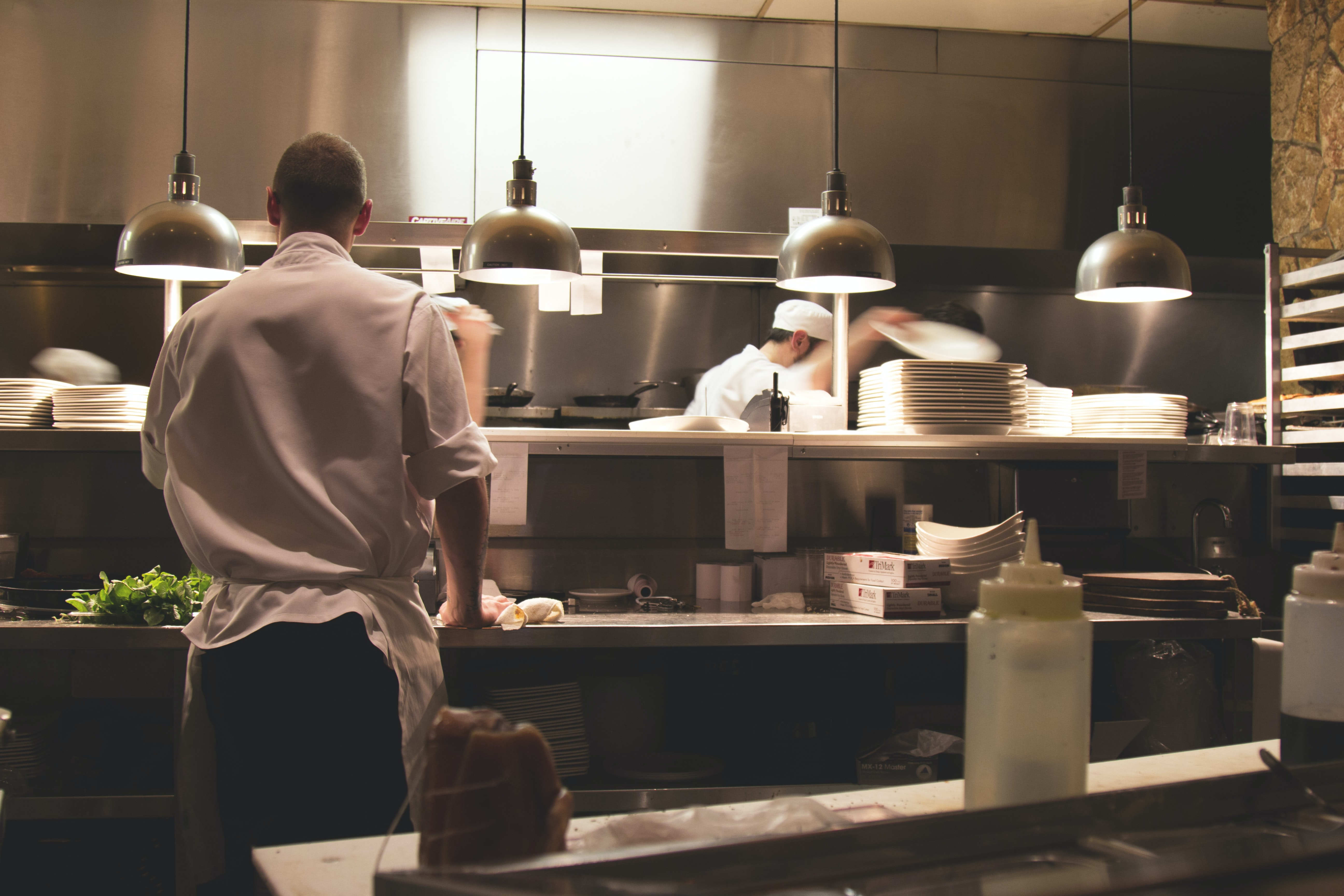 A chef preparing food in the kitchen of a restaurant