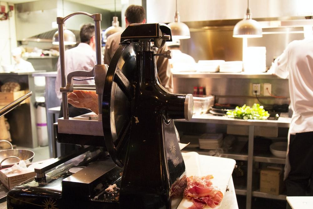 meat grinder on table inside kitchen
