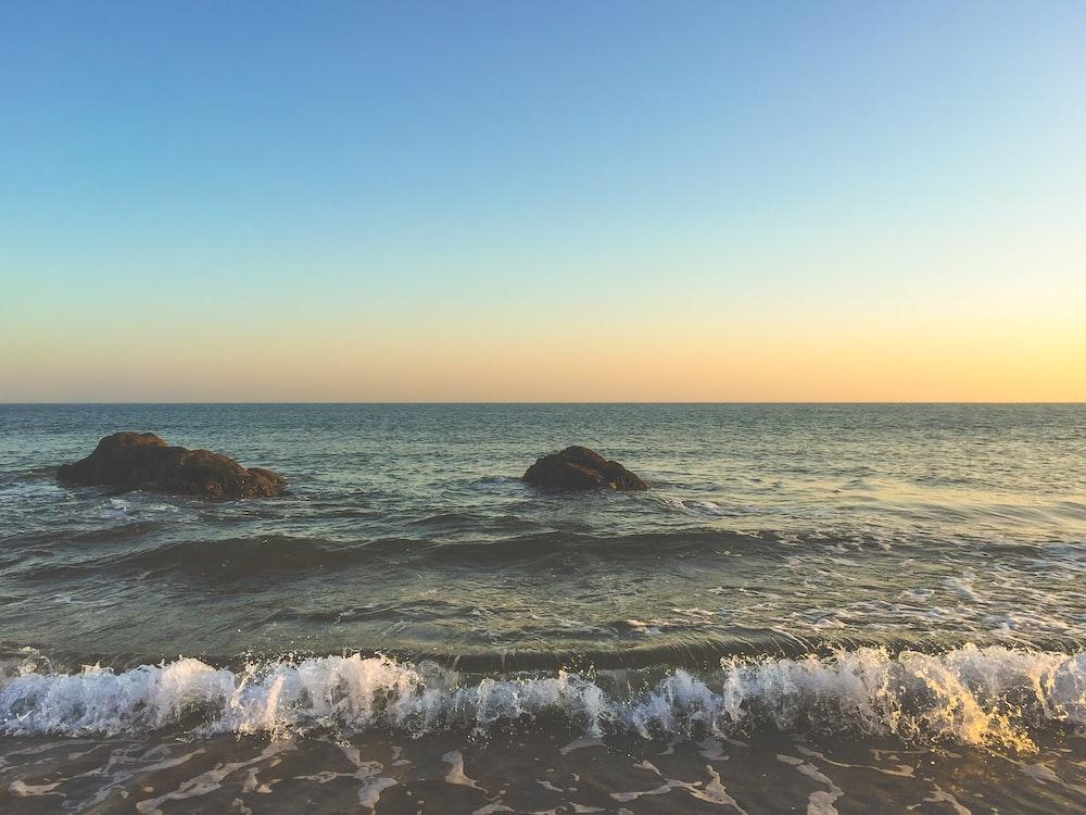 photo of waves crushing on seashore