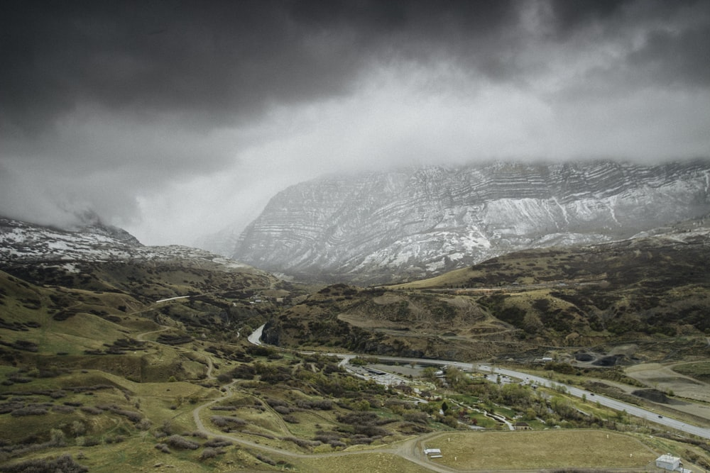 landscape photography of snow-covered mountain under cloudy sky during daytime