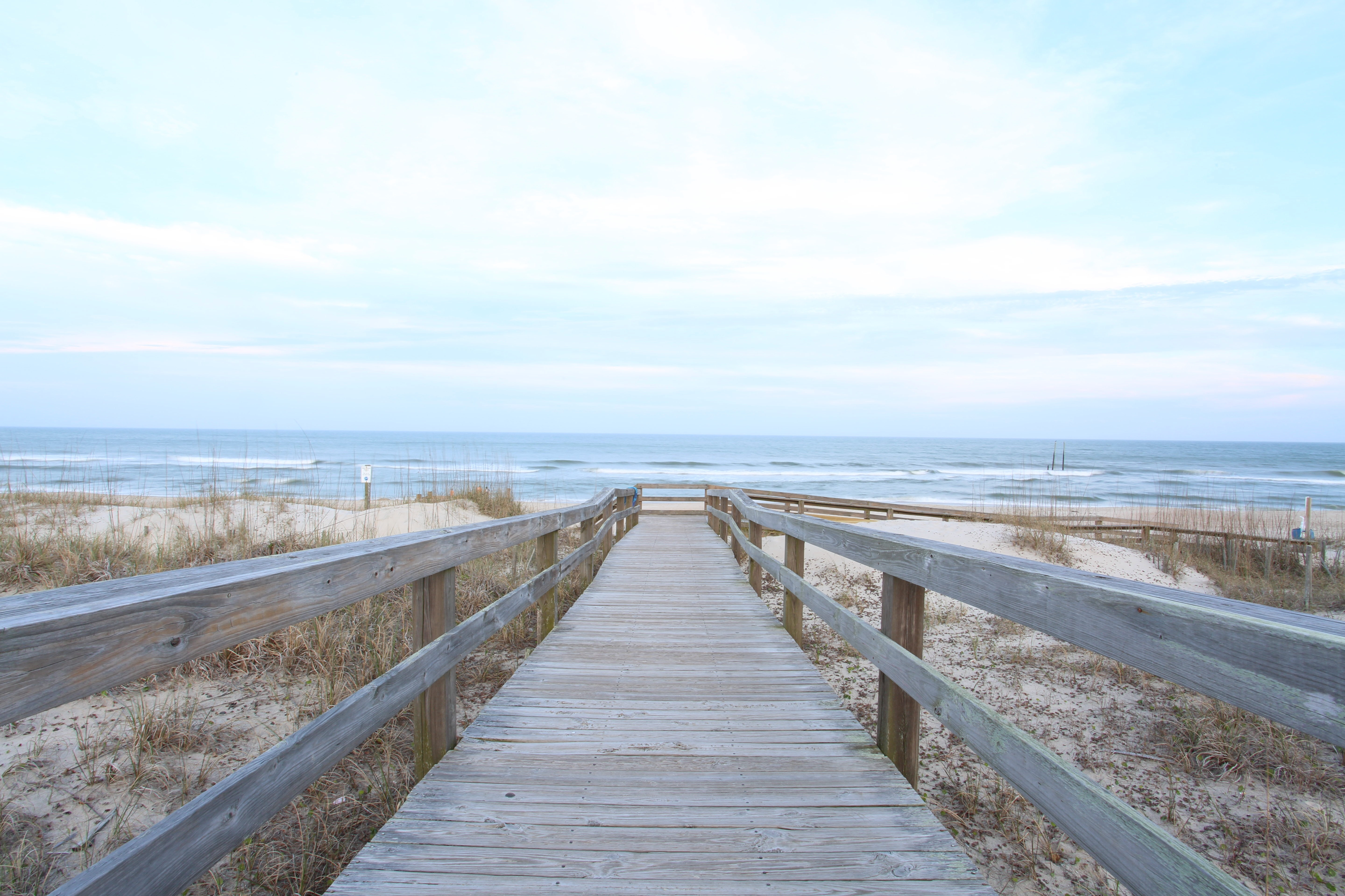 A boardwalk on an empty sandy beach